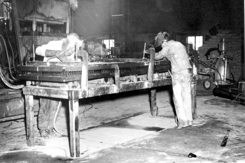Figure 2. Photograph of the construction of a steel building panel in a jig, Peoria, Illinois, circa 1938. Courtesy of the Margaret Estes Library, LeTourneau University, Longview, Texas Robert G. LeTourneau Collection.