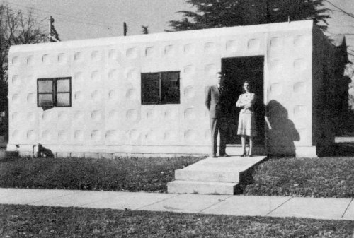 "Figure 10. Tournapull Houses Toccoa Chamber of Commerce (caption). ""Toccoa's Chamber of Commerce organized last year is housed in a LeTourneau one-room steel dwelling leased from Tournapull Housing Corp. In photo are Henry Hunt, chamber secretary, and Mrs. Josephine Andrews Edsall, stenographer. The office is located on the Sage and Tugalo streets corner of Courthouse Square."" NOW, vol. 10, no. 41 (February 22, 1946)."