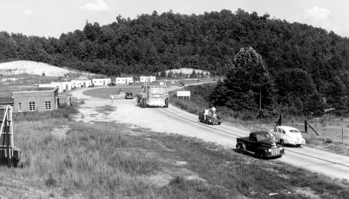 "Figure 19. ""LeTourneau's Baby Tournalayer Under Way to Motel Site,"" 1951, Toccoa, Ga., photograph, courtesy of Dale Hardy of LeTourneau Technologies and R.G. LeTourneau Heritage Center. LeTourneau's Baby Tournalayer is shown traveling to the motel site to cast the three rooms."
